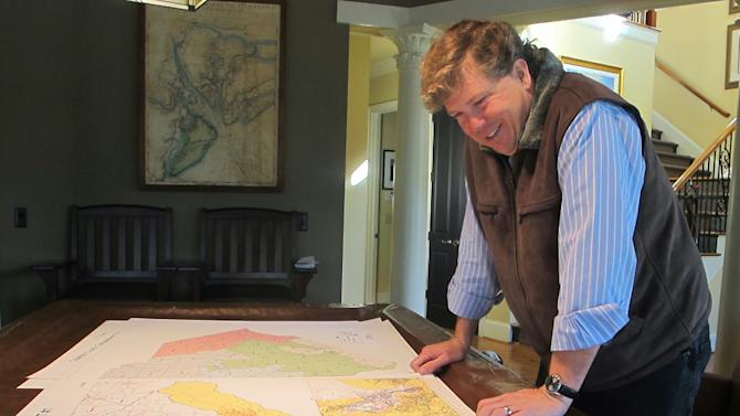 Teddy Turner, son of media magnate Ted Turner, looks over a map of South Carolina's 1st Congressional District in his home in Mount Pleasant, S.C., on Tuesday, Jan. 22, 2012. Turner is now one of at least 10 Republicans and two Democrats seeking former U.S. Rep. Tim Scott's old seat in a district reaching from the sea islands northeast of Charleston southwest to the gated communities on the resort of Hilton Head Island. (AP Photo/Bruce Smith)