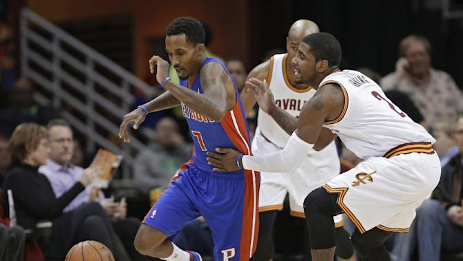Cleveland Cavaliers' Kyrie Irving, right, fouls Detroit Pistons' Brandon Jennings (7) during the first quarter of an NBA basketball game Monday, Dec. 23, 2013, in Cleveland