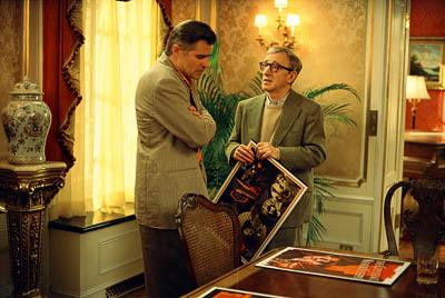 Studio head Hal Yeager ( Treat Williams ) shows director Val Waxman ( Woody Allen ) some poster ideas for his latest picture in Dreamworks' Hollywood Ending