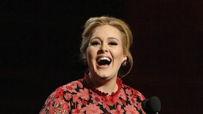 Adele presents the award for album of the year at the 55th annual Grammy Awards on Sunday, Feb. 10, 2013, in Los Angeles. (Photo by John Shearer/Invision/AP)