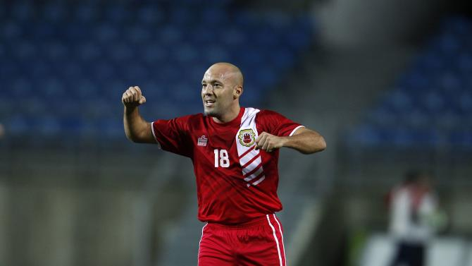 Gibraltar's Al Greene celebrates after his team's international friendly soccer match against Slovakia at Algarve stadium near Faro