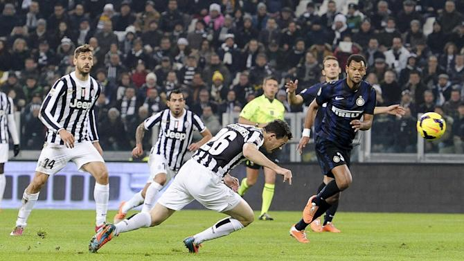 Juventus defender Stephan Lichtsteiner, of Switzerland, scores a goal during a Serie A soccer match between Juventus and Inter Milan at the Juventus stadium, in Turin, Italy, Sunday, Feb. 2, 2014