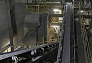 This Jan. 27, 2017 photo, at American Rock Salt Co. shows the process gallery where road salt gets crushed and screened to proper gradation at the mine in Hampton Corners, N.Y. More than 1,200 feet below farm country in upstate New York, the company mines a seam of salt left from a massive sea that dried up 400 million years ago. The deposit is accessible today by an elevator that descends as deep as the Empire State Building is high. (AP Photo/Jeffrey T. Barnes)