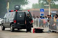 Police are seen patrolling an area near Tiananmen Square in Beijing, on May 1, on the eve of US Secretary of State Hillary Clinton's visit to China. Clinton arrived in Beijing on Wednesday for talks with Chinese leaders that risk being overshadowed by the case of a blind activist said to be under US protection after fleeing house arrest