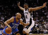 Oklahoma City Thunder's Derek Fisher (L) and San Antonio Spurs' Gary Neal during game one of the NBA Western Conference Finals on May 27. The Spurs' 101-98 win moved them one game closer to booking their berth in the NBA Finals