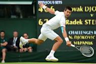 Serbia's Novak Djokovic plays a backhand shot during his third round men's singles match against Czech Republic's Radek Stepanek at the All England Tennis Club in Wimbledon, southwest London. Djokovic eased into the fourth round with a 4-6, 6-2, 6-2, 6-2 win over Stepanek