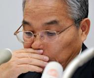 This file photo shows Japan's Elpida Momory president Yukio Sakamoto announcing company's filing for bankruptcy protection, at the Tokyo Stock Exchange, in February. Elpida, one of the world's top microchip makers, was delisted from the Tokyo Stock Exchange late March in the biggest corporate failure in Japanese manufacturing history