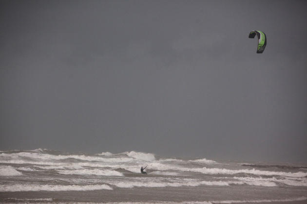 A man kitesurfs in the Mediterranean Sea in Tel Aviv