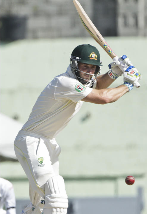 Australia's batsman Shaun Marsh plays a shot during the opening day of their first cricket Test match against the West Indies in Roseau, Dominica, Wednesday, June 3, 2015. (AP Photo/Arnulfo Franco