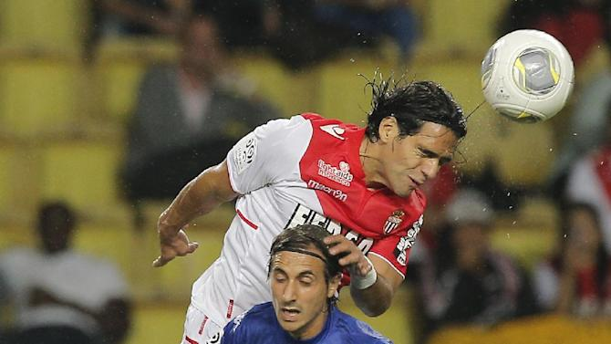 Monaco's Falcao of Colombia, top,  challenges for the ball with Bastia's Fethi Harek of Algeria during their French League One soccer match, in Monaco stadium, Wednesday, Sept, 25, 2013