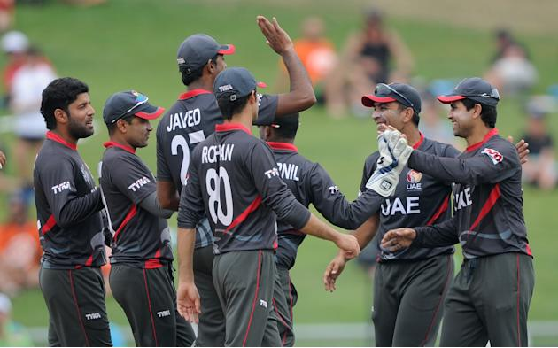 United Arab Emirates players celebrate after the run out of Pakistan's Ahmad Shahzad during their Cricket World Cup Pool B match in Napier, New Zealand, Wednesday, March 4, 2015. (AP Photo Ross Se