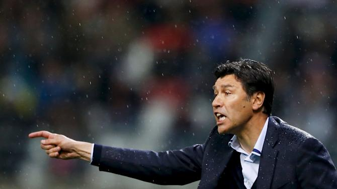 Olympique Lyon's coach Hubert Fournier reacts during their French Ligue 1 soccer match against Reims at Auguste Delaune Stadium in Reims