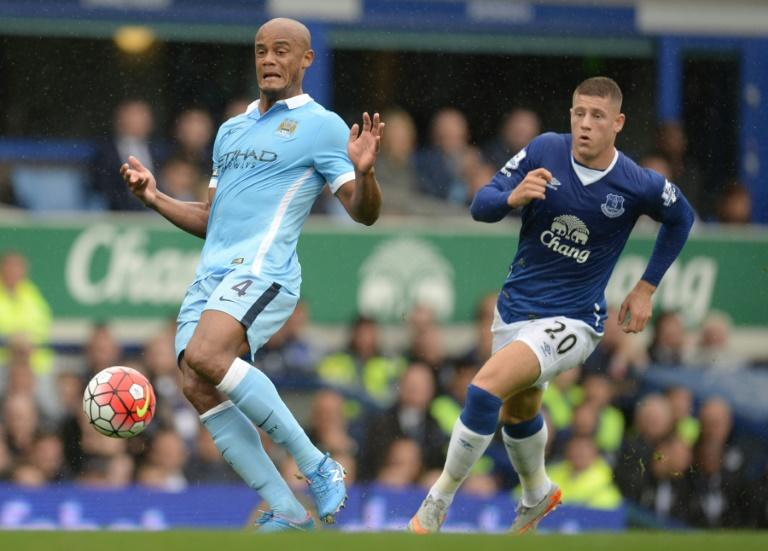 Everton's Ross Barkley (R) chases Manchester City's Vincent Kompany during their English Premier League match, at Goodison Park in Liverpool, on August 23, 2015