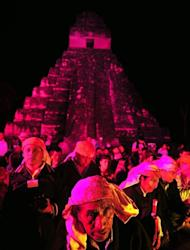 Guatemalan Mayan natives take part in celebrations marking the end of the Mayan era at the Tikal archaeological site, 560 kms north of Guatemala City, on December 21, 2012. A global day of lighthearted doom-themed celebration and superstitious scare-mongering culminated Friday in the jungle temples built by the Mayan people of Central America, whose calendar sparks fears of apocalypse