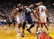 David West of the Indiana Pacers and Mario Chalmers of the Miami Heat get tangled up during Game Two of the Eastern Conference Semifinals in the 2012 NBA Playoffs on May 15, 2012 in Miami, Florida. West scored 16 points and George Hill had 15 as the Indiana Pacers defeated the Miami Heat 78-75