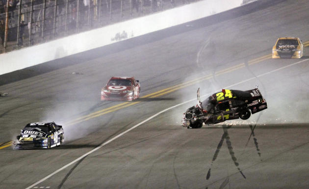 Jeff Gordon's car (24) flips after he was involved in a wreck with several other cars, including Jimmie Johnson (48), as Juan Pablo Montoya, second from left, and Ryan Newman make moves to avoid them