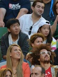 Women's Singles Champion Belarus's Victoria Azarenka watches Serbia's Novak Djokovic in Melbourne on January 27, 2013. The world number one's tennis-playing stock has never been higher, but further repairs to her image may be appropriate