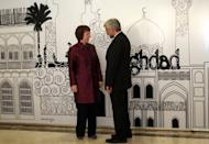 "Iran's chief nuclear negotiator and head of Iran's national security council Saeed Jalili (R) chats European Union foreign policy chief, Catherine Ashton, before a meeting in Baghdad on May 23. Tehran has ""no reason"" to suspend its enrichment of uranium to 20 percent, one of the key demands of world powers engaging Iran in talks, the head of its Atomic Energy Organisation said late Saturday"