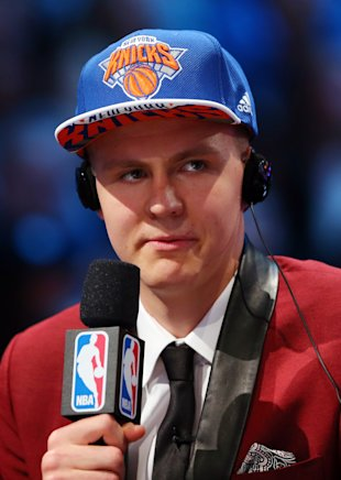Kristaps Porzingis requests that his employers stop talking. (Elsa/Getty Images)