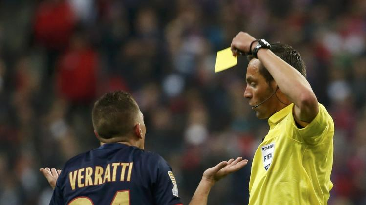 Paris St Germain's Verratti gets a yellow card during the French League Cup final soccer match against Olympique Lyon at the Stade de France stadium in Saint-Denis
