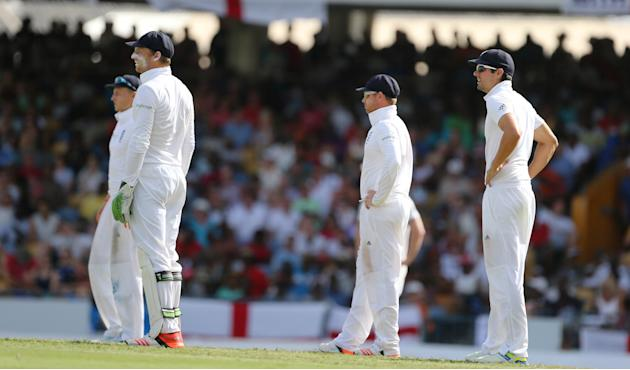 Cricket: England's Ian Bell, Jos Buttler and Alastair Cook in the field