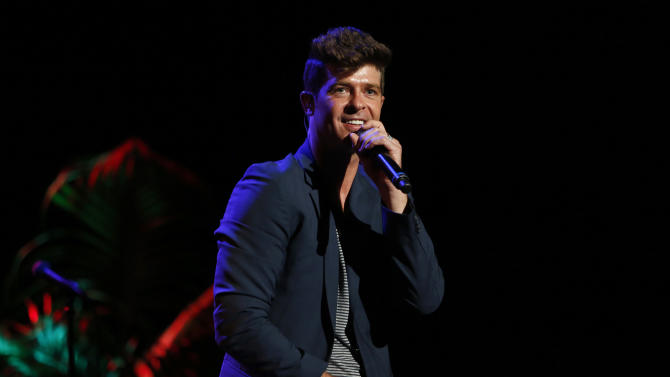 "FILE - This Sept. 15, 2012 file photo originally released by Point Foundation shows singer Robin Thicke performing at the ""Voices On Point"" Concert & Gala in Los Angeles. Thicke's, ""Blurred Lines,"" was the most viral track on Spotify from Monday, March 25, to Sunday, March 31.  (AP Photo/Point Foundation, Colin Young-Wolff, file)"