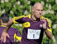 British referee Howard Webb runs during a referees workshop before the Euro 2012 in Warsaw. A sterling performance by England at Euro 2012 would be such a boost that it would be worth missing out on overseeing the tournament's finals for, Webb said on Wednesday