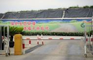 """A sign in Chinese characters says """"Protect the ecological enviroment for the happiness of future generations"""" is displayed near a garbage dump in Songjiang district. Environmental pollution and perceived health threats are sparking protests in China"""