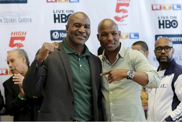 Former heaxyweight boxing champion Holyfield and boxer Hopkins pose as they attend the official weigh-in of reigning heavyweight champion Klitschko of Ukraine and U.S. boxer Jennings ahead of their fi