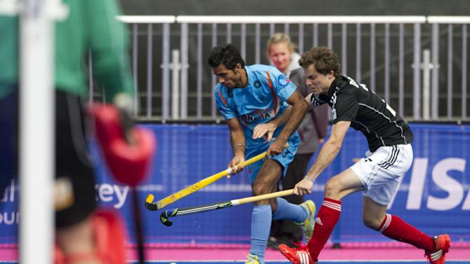 "India's Gurbaj Singh (L) vies with Germany's Oskar Deecke during their International Invitational Hockey Tournament match, part of the ""London Prepares"" series of test events, at the Riverbank Arena at the Olympic Park in London on May 5, 2012. AFP PHOTO / MIGUEL MEDINAMIGUEL MEDINA/AFP/GettyImages"