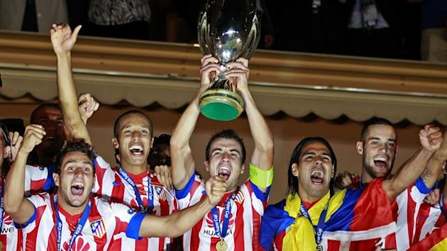 Atletico Madrid's captain Gabi (C) holds up the trophy beside Falcao (R) as the team celebrates their European Super Cup soccer match win against Chelsea at Louis II stadium in Monaco (Reuters)