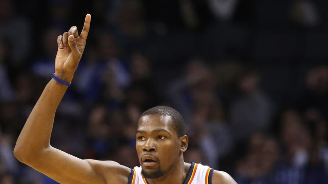 Oklahoma City Thunder forward Kevin Durant (35) gestures after making a basket in the second quarter of an NBA basketball game against the Brooklyn Nets in Oklahoma City, Thursday, Jan. 2, 2014. (AP Photo/Sue Ogrocki)