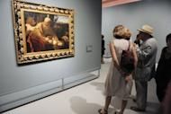 """Visitors look at the painting """"Sacrifice of Isaac"""" by Italian artist Michelangelo Merisi known as Caravaggio, in June 2012 at the Fabre Museum in Montpellier, France. Italian art experts have reportedly discovered around 100 drawings and a number of paintings by the young Renaissance master Caravaggio in a find that could be worth up to 700 million euros"""