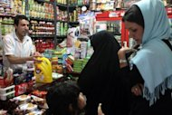 Iranian women shops at a grocery store in Tehran in September 2012. Iran's currency, the rial, slipped another four percent on Tuesday to close at 36,100 to the dollar, according to exchange tracking websites.