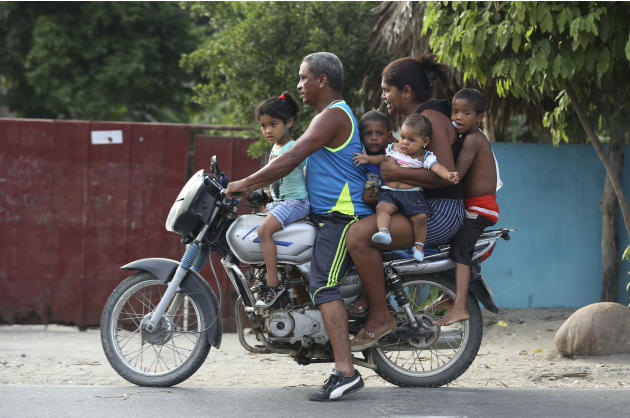 A family rides together on a motorbike in Aracataca, the hometown of the late Nobel laureate Gabriel Garcia Marquez along Colombia's Caribbean coast on Friday, April 18, 2014. Garcia Marquez died