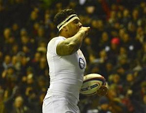 England's Tuilagi clebrates after scoring a try during their Six Nations rugby match against France at Twickenham stadium in London