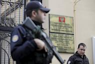 Turkish riot police stand guard in front of the Russian Consulate in central Istanbul, Turkey, November 24, 2015. Turkish fighter jets shot down a Russian warplane near the Syrian border on Tuesday after repeated warnings over air space violations, but Moscow said it could prove the jet had not left Syrian air space. REUTERS/Kemal Aslan