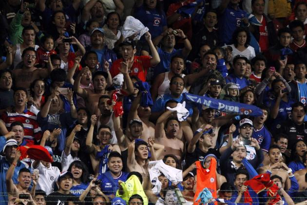 Fans of Mexico's Cruz Azul celebrate after winning their CONCACAF Champions Cup final soccer match against Mexico's Toluca in Toluca