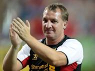 Brendan Rodgers, manager of Liverpool FC, acknowledges the crowd after his side won the World Football Challenge match against Toronto FC on July 21. Rodgers' first game as manager of Liverpool ended in a 1-1 draw against FC Toronto thanks to Adam Morgan's equaliser
