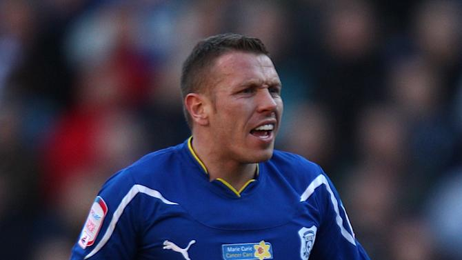 Liverpool striker Craig Bellamy is in talks over a return to Cardiff
