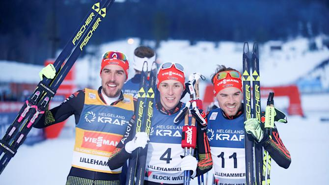 Second placed Johannes Rydzek of Germany, first placed Eric Frenzel of Germany and third placed Fabian Riessle of Germany pose after men's Nordic Combined Gunder 10 km event at the FIS World Cup in Lillehammer