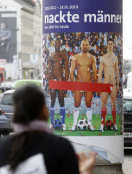 "In this picture taken Oct. 18, 2012 a person passes a poster showing three naked men which has had red tape added to cover the sensitive parts of the three men, in Vienna, Austria. Poster reads: ""Naked Men"". A prestigious Vienna museum, The Leopold Museum, has been forced to cover up a graphic poster advertising a new show devoted to male nudity, after protests that it is offensive. The show — ""Nude Men from 1800 to Today"" — opened its doors Friday Oct. 20, looking at how artists have dealt with the theme of male nudity over the centuries. (AP Photo/Ronald Zak)"