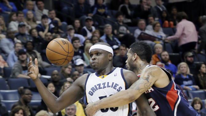 Memphis Grizzlies' Zach Randolph, left, is fouled by Atlanta Hawks' Mike Scott, right, in the second half of an NBA basketball game in Memphis, Tenn., Sunday, Jan. 12, 2014. The Grizzlies won 108-101