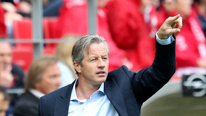 Schalke head coach Jens Keller gestures during a German soccer Bundesliga match between FSV Mainz 05 and FC Schalke 04 in Mainz, Germany, Saturday, Sept. 14, 2013