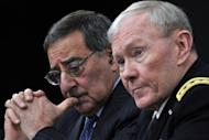 US Secretary of Defense Leon Panetta and Chairman of the Joint Chiefs of Staff General Martin E. Dempsey at a press conference January 24, 2013 at the Pentagon. The United States will have to keep up an open-ended drone war against Al-Qaeda militants in Pakistan and elsewhere to prevent another terror attack on America, Panetta said