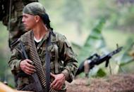 A member of the Revolutionary Armed Forces of Colombia (FARC) mans a checkpoint near the municipality of Toribio, department of Cauca, Colombia, in July 2012. Founded in 1964, the Marxist-inspired FARC -- Latin America's largest and longest-fighting insurgency -- is believed to have some 9,000 fighters, most of them hiding out in mountainous and jungle areas