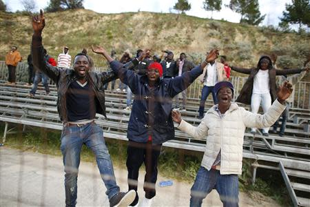 African migrants, who are supporters of the ASD Mineo soccer team, celebrate after a goal in the Sicilian village of Mineo