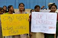 Indian activists from 'Campaign Against Child Labour' demonstrate outside the French consulate in Bangalore, on June 18, 2012. The Indian wife of a French consular official charged with raping their daughter has demanded a meeting with Francois Hollande, presenting the French president with a thorny diplomatic dilemma on his first state visit to India