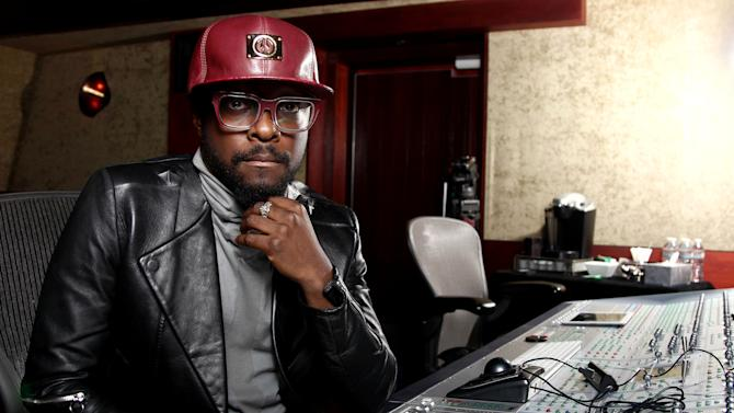 In this April 24, 2013 photo, will.i.am poses for a portrait in Los Angeles. The Black Eyed Peas frontman is computer chip-maker Intel's director of creative innovation. He's also partnered with Coca-Cola to create a new brand of products from recycled bottles and cans, including headphones and clothes. (Photo by Matt Sayles/Invision/AP)