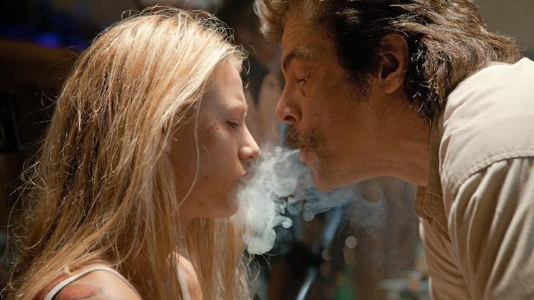 "This film image released by Universal Pictures shows Blake Lively, left, and Benicio Del Toro in a scene from ""Savages."" (AP Photo/Universal Pictures, Francois Duhamel)"